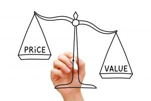 Hand drawing Value Price scale concept with black marker on transparent wipe board isolated on white.